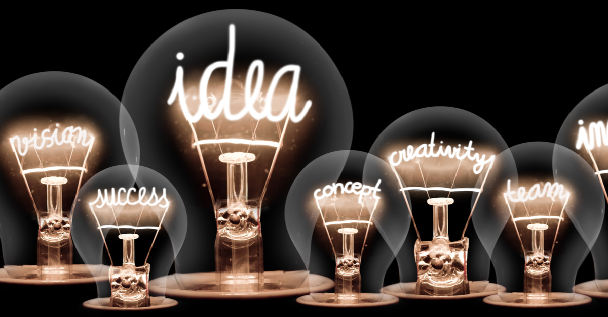 Stylized industrial lightbulbs with filaments that spell out inspirational words